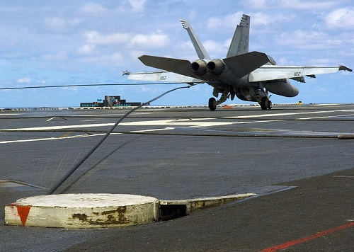 F-18 landing with an arresting wire aboard a US aircraft carrier